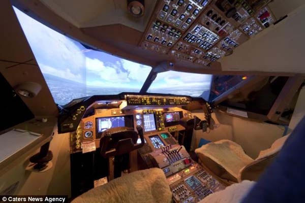 14095579124550 cockpit2 Forced to give up his dream of being a pilot, this man builds a life sized Boeing simulator in his house!