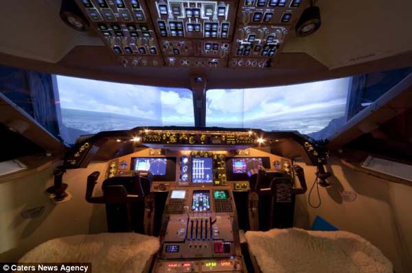 14095579125024 cockpit5 Forced to give up his dream of being a pilot, this man builds a life sized Boeing simulator in his house!