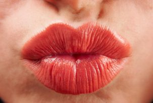 istock 000016931860 small1 303x204 Just How Gross is Kissing?