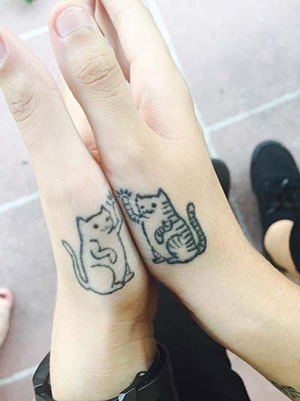 minimalistic cat tattoo 53  605 Cat lovers would Love this: 20 Minimalistic Cat Tattoos for Cat Lovers